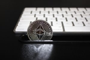 What is the EIP-1559 update that will modify the Ethereum fee structure?